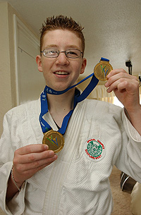 Brian shows off his two olympic gold medals