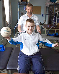 Alex Gray with his physiotherapist Jon Hasler at the Southern General Hospital's Queen Elizabeth Spinal Unit
