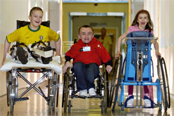 John leads Yorkhill patients Shaun McDougall, 12, from Clydebank, and Alexis Martin, 7, from Irvine, to the MediCinema, below